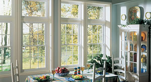 A dining room with Keystone Window of Pennsylvania's Vinyl replacement windows.