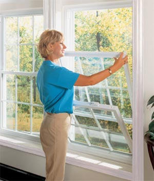 Woman opening double-hung window