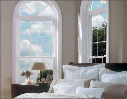 White Double Hung Windows with Colonial Grids and Circle Top Geometric Windows with Star Burst Grids